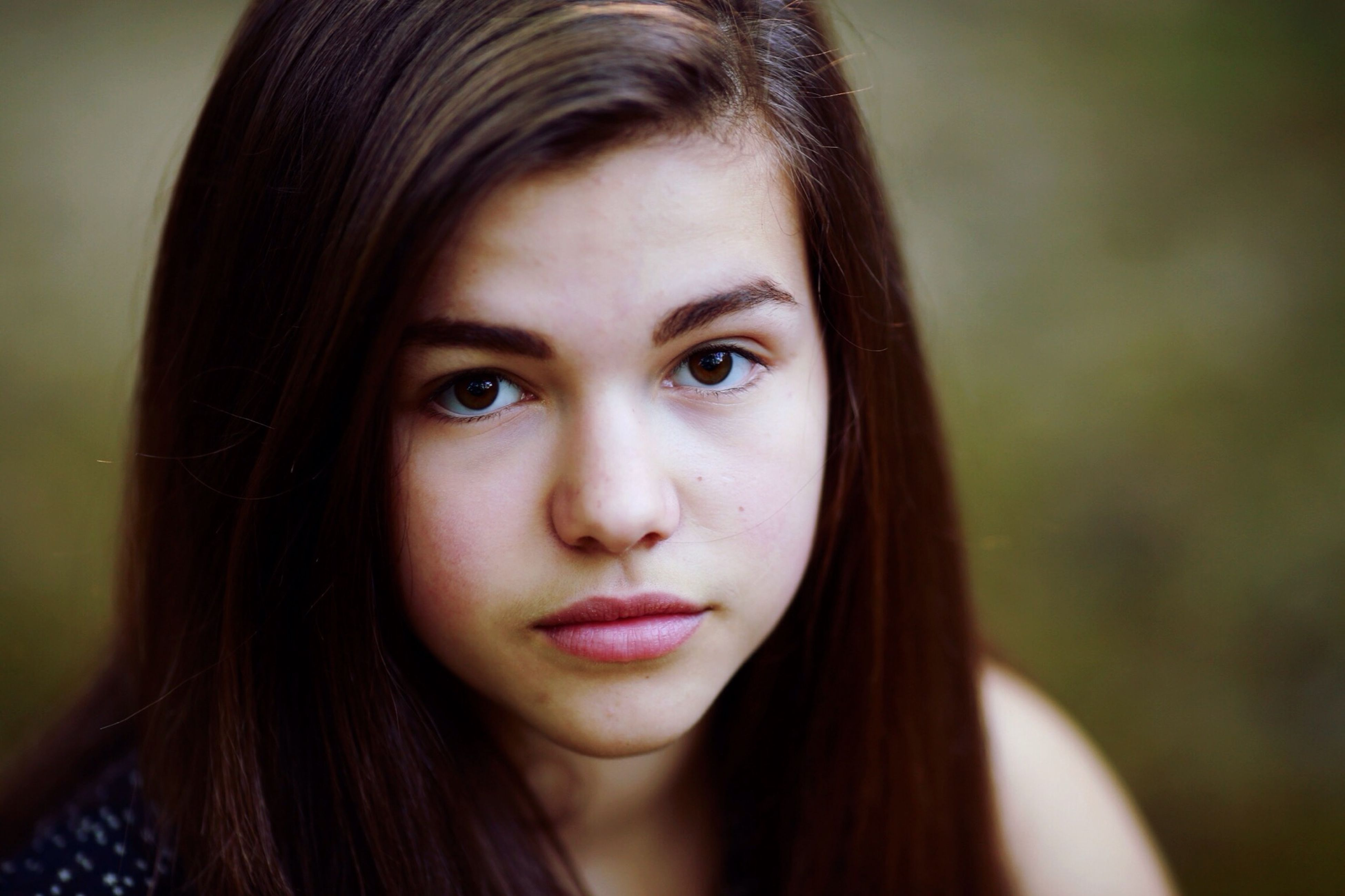 headshot, looking at camera, portrait, young women, young adult, long hair, person, close-up, focus on foreground, lifestyles, front view, human face, head and shoulders, leisure activity, brown hair, beauty, contemplation