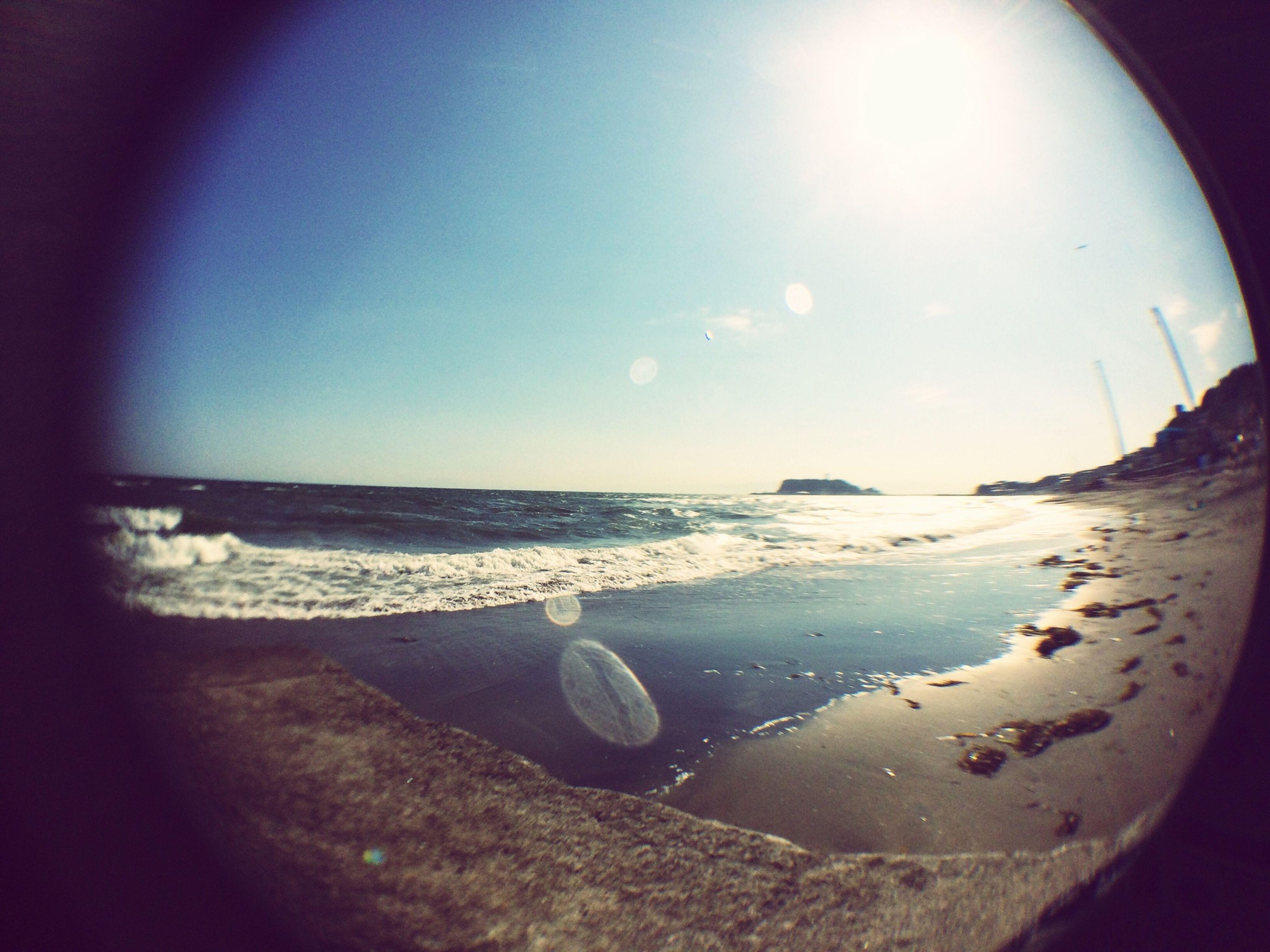 sea, beach, horizon over water, water, shore, sand, scenics, tranquility, tranquil scene, sky, beauty in nature, nature, coastline, sunlight, sun, wave, idyllic, fish-eye lens, surf, vacations