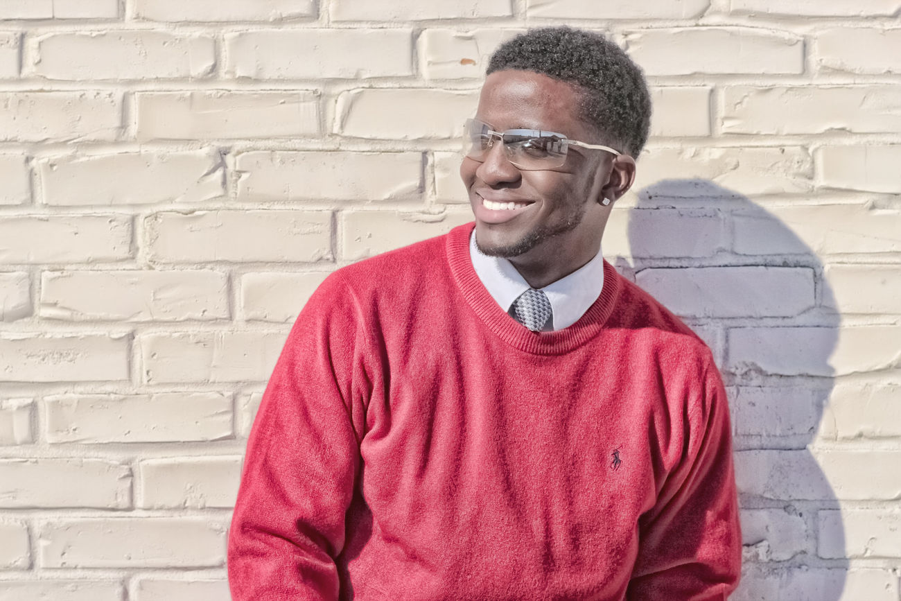 A D Smoove Adult Black Man Brick Wall Canon_photos Canonphotography Eyeglasses  Handsome Model One Person Outdoors Portrait Red Smiling Standing Sweater White Wall Young Adult