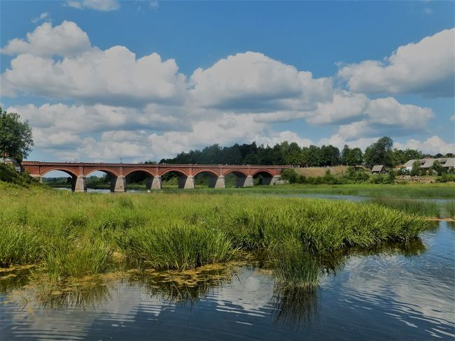 Landscape_Collection Arch Arch Bridge Architecture Bridge Bridge - Man Made Structure Built Structure Cloud - Sky Day Kuldiga Landscape Landscape_photography Nature No People Outdoors River Sky Transportation Tree Water Waterfront