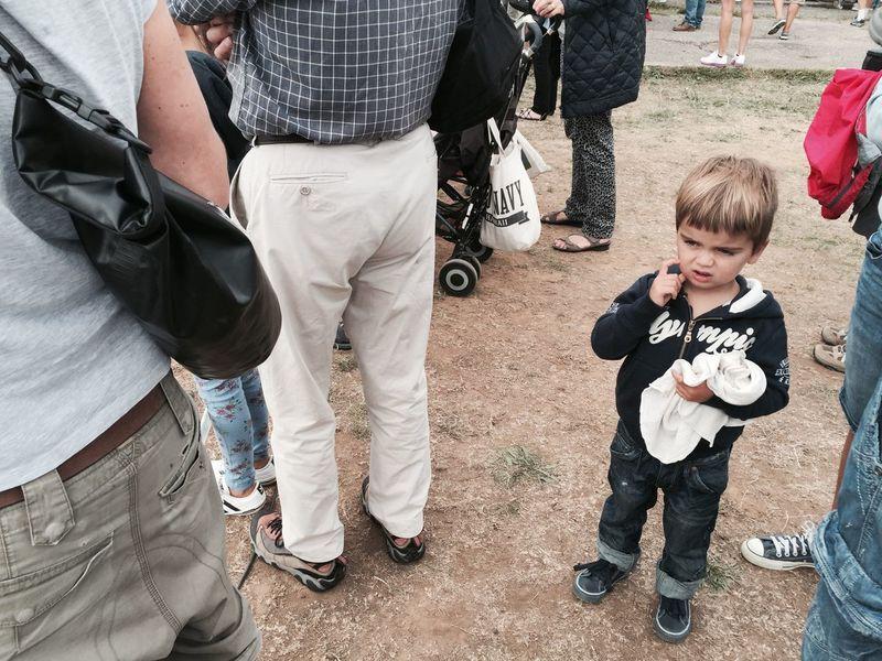 Little Boy Wandering Around Airshow Crowd