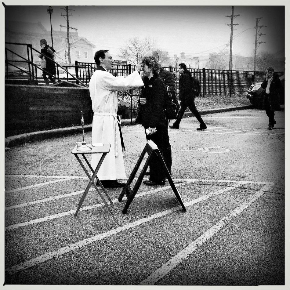 Ash Wednesday for busy commuters. Full Length Lifestyles Real People Leisure Activity Walking Childhood Playing Day Outdoors Men Togetherness Architecture Adult People Ash Wednesday Religion Streetphoto_bw My Commute Shootermag Streetphotography Religion And Beliefs