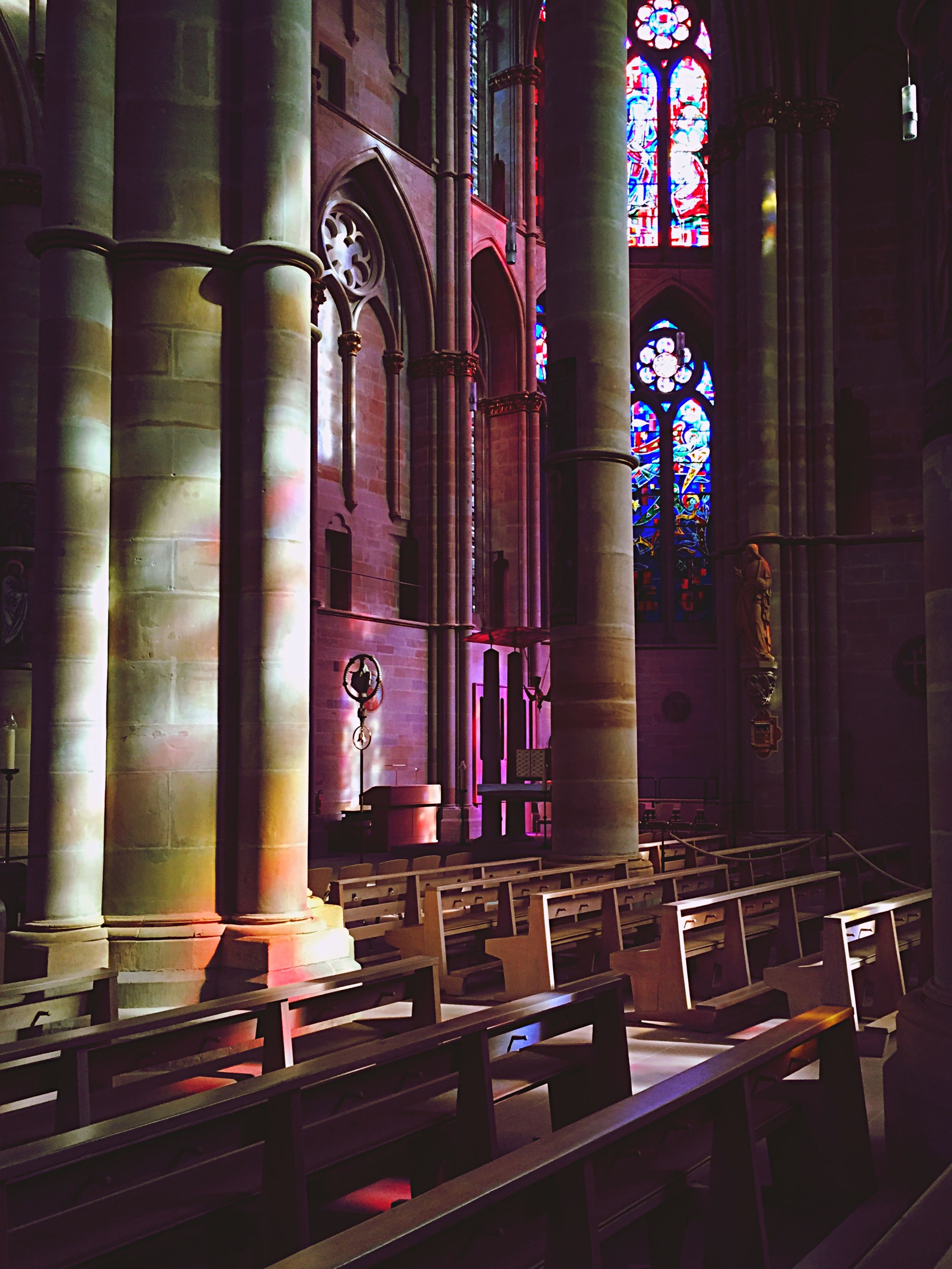 architecture, built structure, illuminated, indoors, night, building exterior, window, place of worship, religion, church, lighting equipment, no people, architectural column, city, building, spirituality, absence, interior