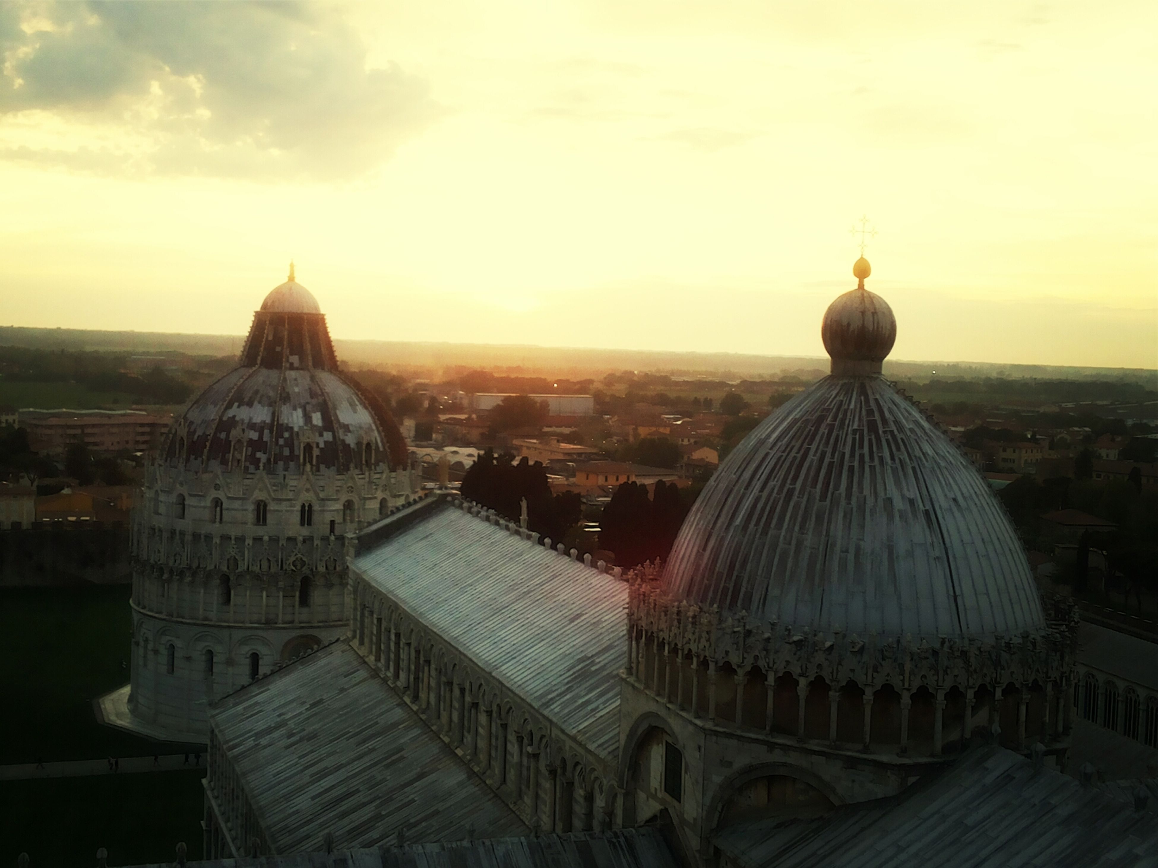architecture, building exterior, built structure, dome, place of worship, religion, spirituality, sky, sunset, cityscape, city, travel destinations, famous place, church, cathedral, travel, roof, cloud - sky, high angle view