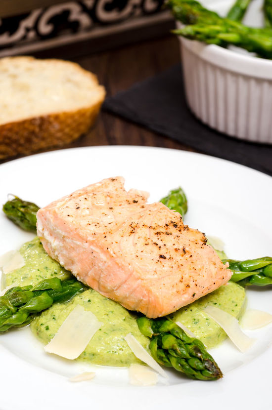Roasted salmon on green asparagus in vertical format Green Asparagus Bread Close-up Day Fish Food Food And Drink Freshness Healthy Eating High Angle View Indoors  No People Plate Portrait Format Ready-to-eat Roasted Roasted Coffee Bean Salmon Vegetable Vertical Format