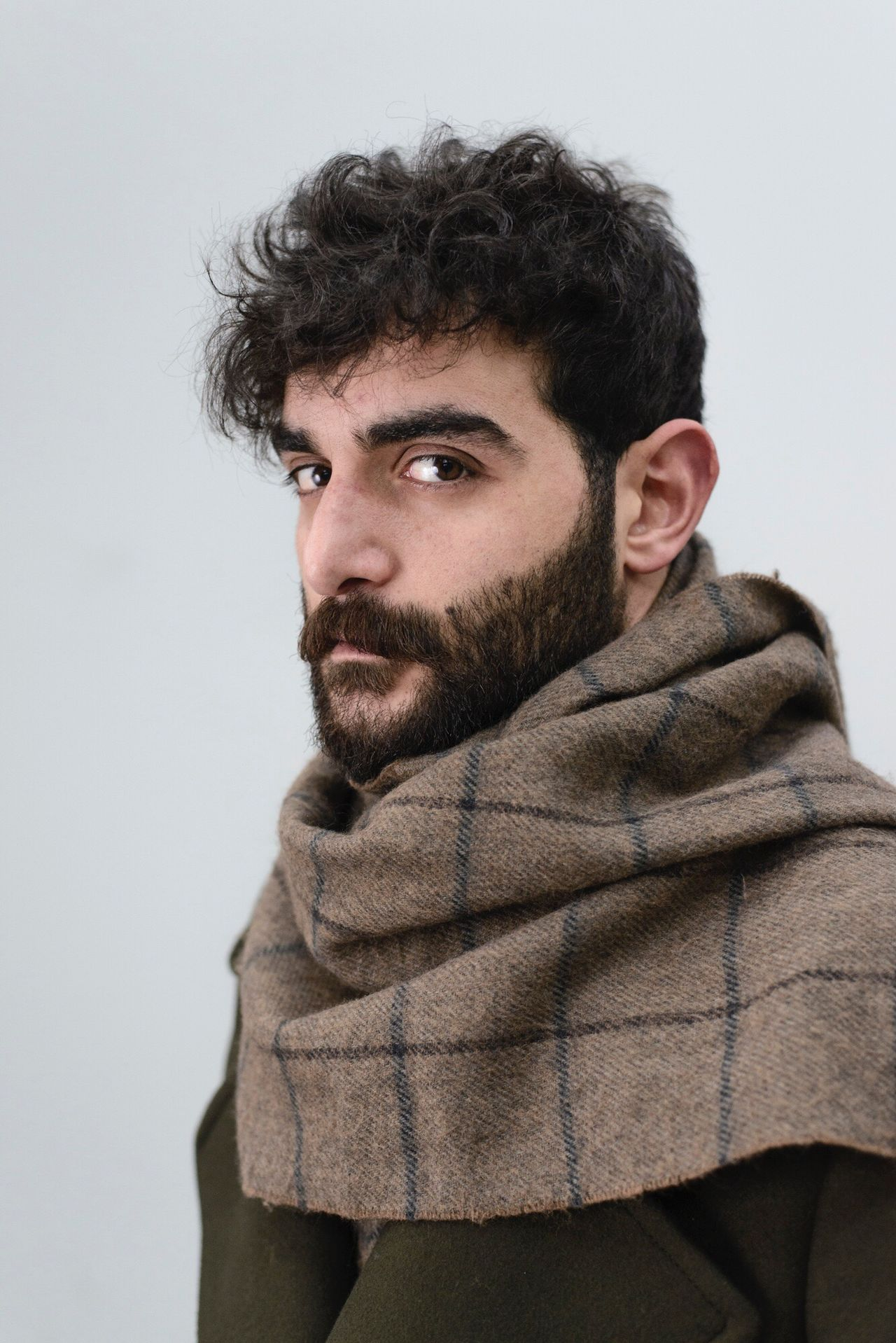 portrait real people one person Looking At Camera beard studio shot young adult lifestyles warm clothing close-up day white background people Adult