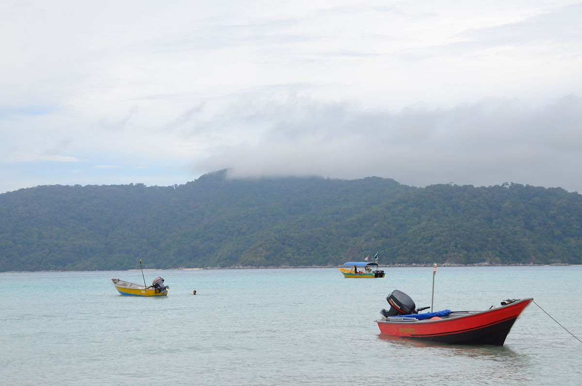 view of boat, hill and foggy sky in the morning Beauty In Nature Boat Cloud - Sky Day Idyllic Journey Mode Of Transport Mountain Mountain Range Nature No People Non-urban Scene Outdoors Perhentian Rippled Sailboat Sailing Scenics Sky Tourism Tranquil Scene Tranquility Transportation Water Waterfront