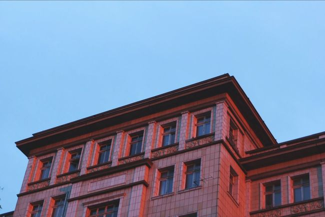 This normally whiite building turned red from the sunset Sunset Berlin Architecture