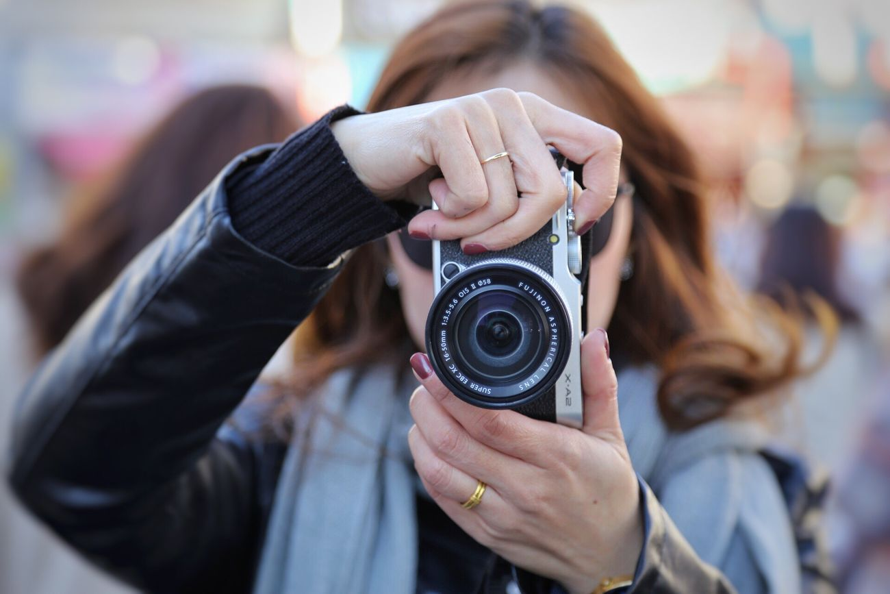 Taking a photo Photography Themes Camera - Photographic Equipment Photographing Photographer Old-fashioned Adults Only Holding One Person Only Women Focus On Foreground Technology Adult One Woman Only Women SLR Camera People Human Body Part Human Hand Close-up Digital Camera