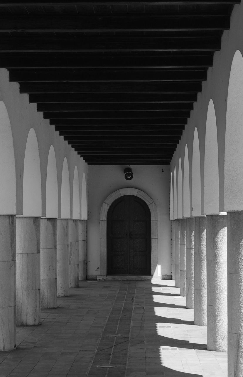 arch, architecture, built structure, in a row, the way forward, architectural column, corridor, indoors, no people, day