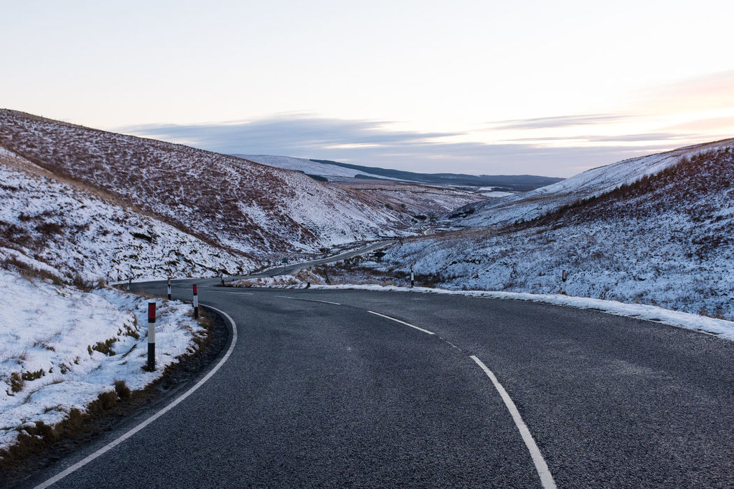 Beauty In Nature Cold Temperature Day Landscape Mountain Mountain Road Nature No People Outdoors Road Scenics Scotland Sky Snow Tire Track Tranquil Scene Tranquility Transportation Winding Road Winter