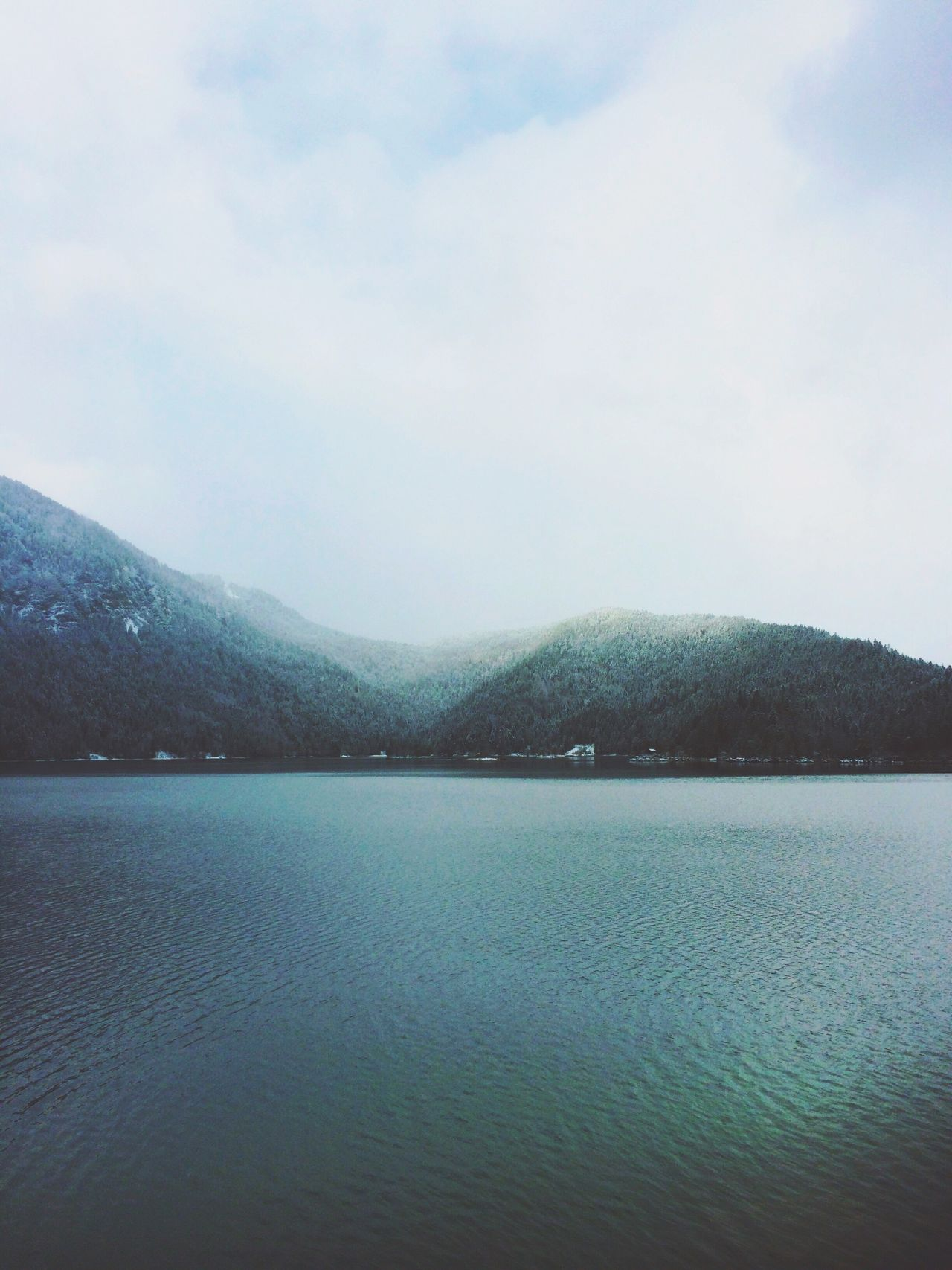 A glimpse of light on a grey day. The Week Of Eyeem Naturelovers Lake View Eye4photography  Alpen Showcase: December IPhoneography Lake EyeEm Nature Lover Shades Of Grey EyeEm Best Shots Mountains And Sky Cold Alps