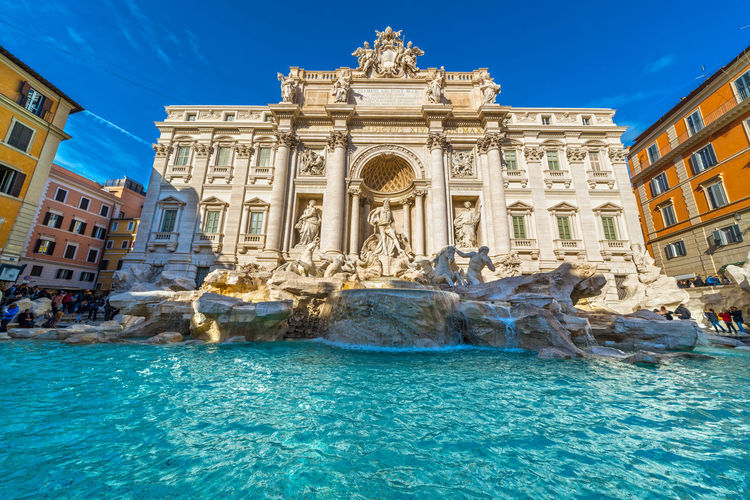 Trevi Fountain, Italy Coliseum Colosseo Pantheon Roma St. Peter's Basilica Trevi Fountain Vatican Architecture Baroque Style Blue Building Exterior Built Structure Clear Sky Day Façade Italy Low Angle View No People Outdoors San Pietro Sant'angelo Sculpture Sky Statue Tiber Travel Destinations Water