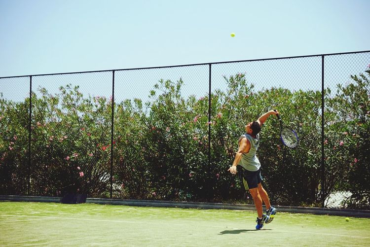 Having a hit Sport Tennis Tennis Ball Court Practicing Outdoors Taking A Shot - Sport Tennis Racket Mid-air Activity Full Length Playing Candid Motion Athlete Sportsman Ball Throwing  One Person Jumping