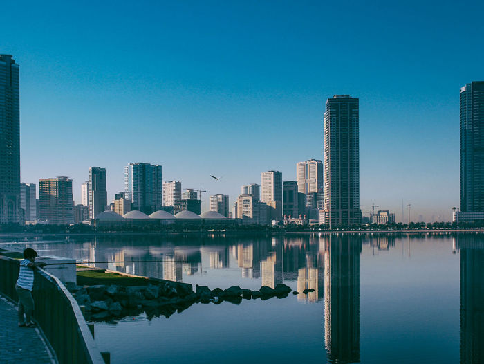 // fishing // Architecture Blue Building Exterior Built Structure City Cityscape Clear Sky Downtown District Live For The Story Modern Outdoors Reflection Reflection Reflection_collection River Shootermag Shootermagazine Sky Skyscraper The Great Outdoors - 2017 EyeEm Awards Tower Travel Destinations Urban Skyline Water Waterfront
