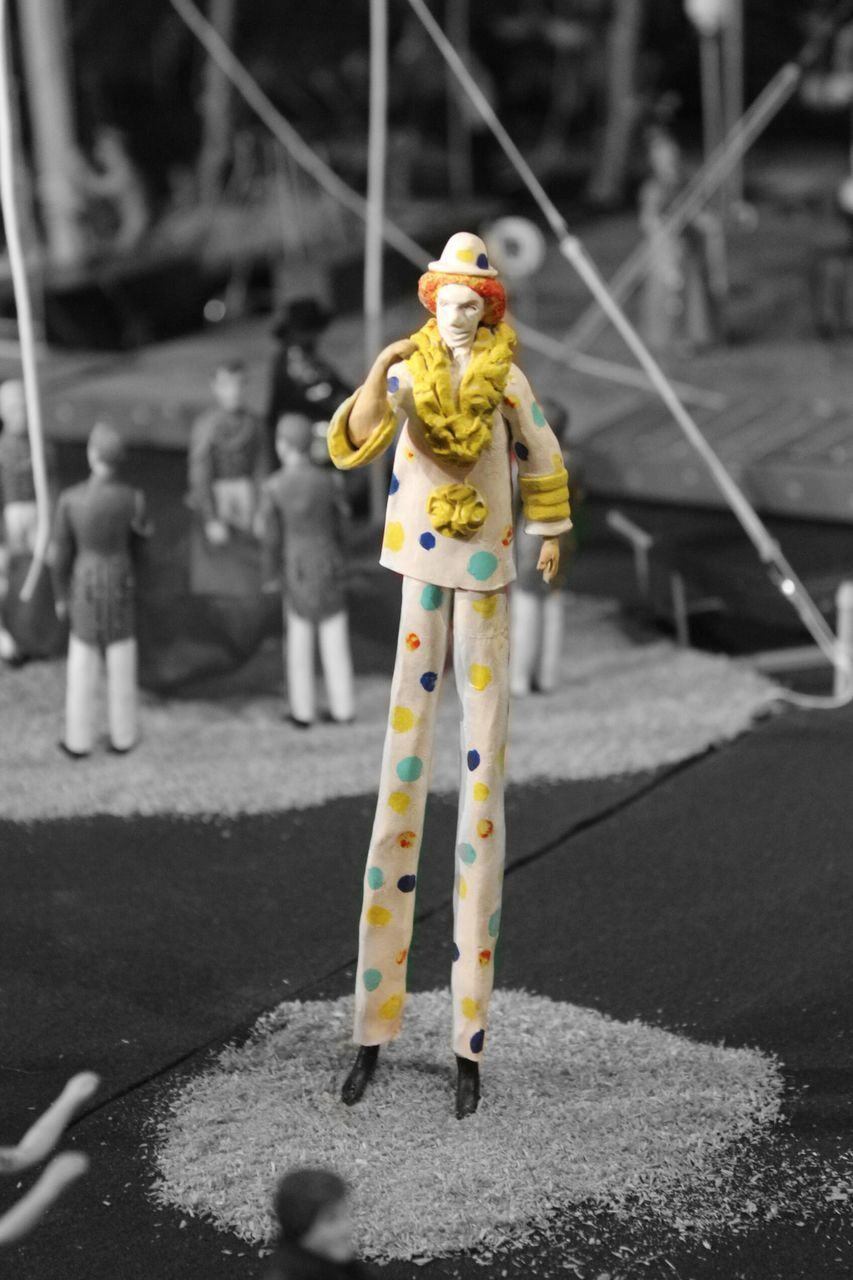 human representation, full length, street, doll, road, day, standing, yellow, outdoors, childhood, one person, clown, close-up, people