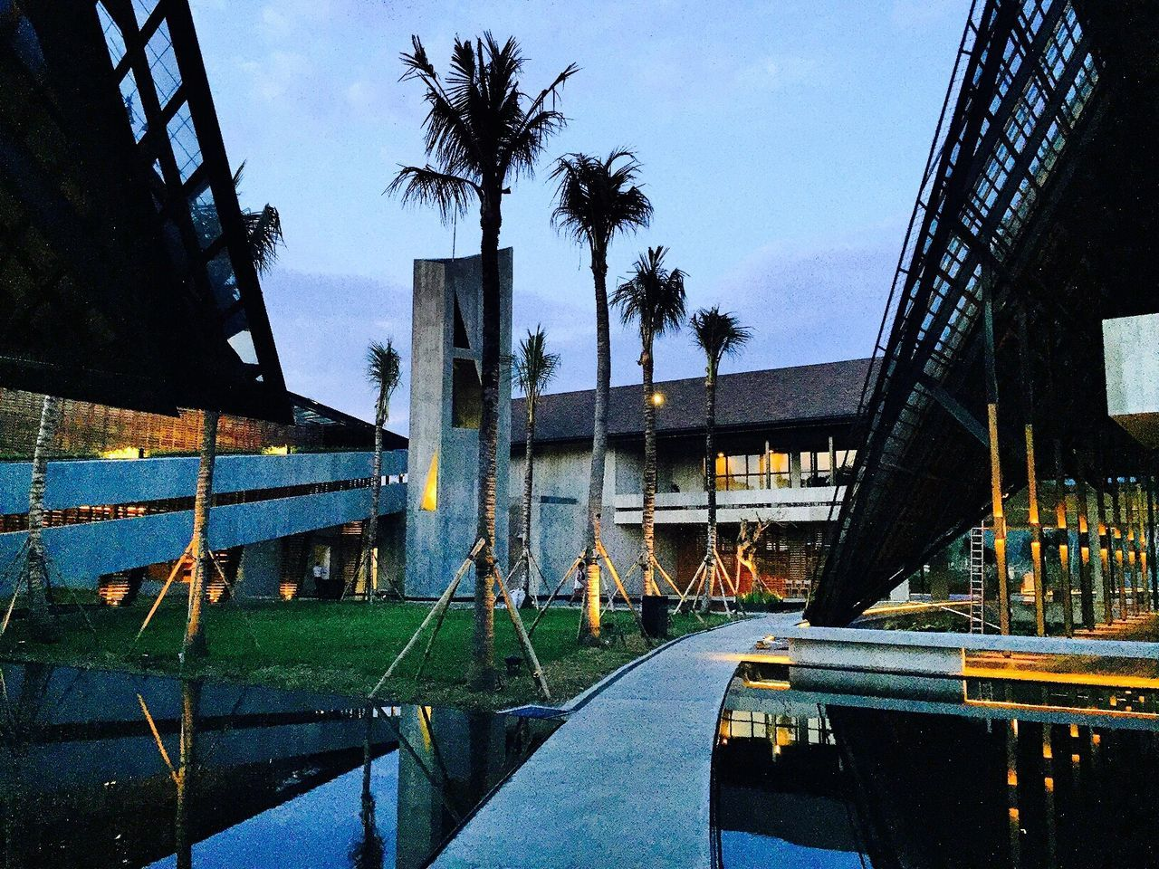 architecture, built structure, day, swimming pool, outdoors, building exterior, water, tree, sky, no people, palm tree, city
