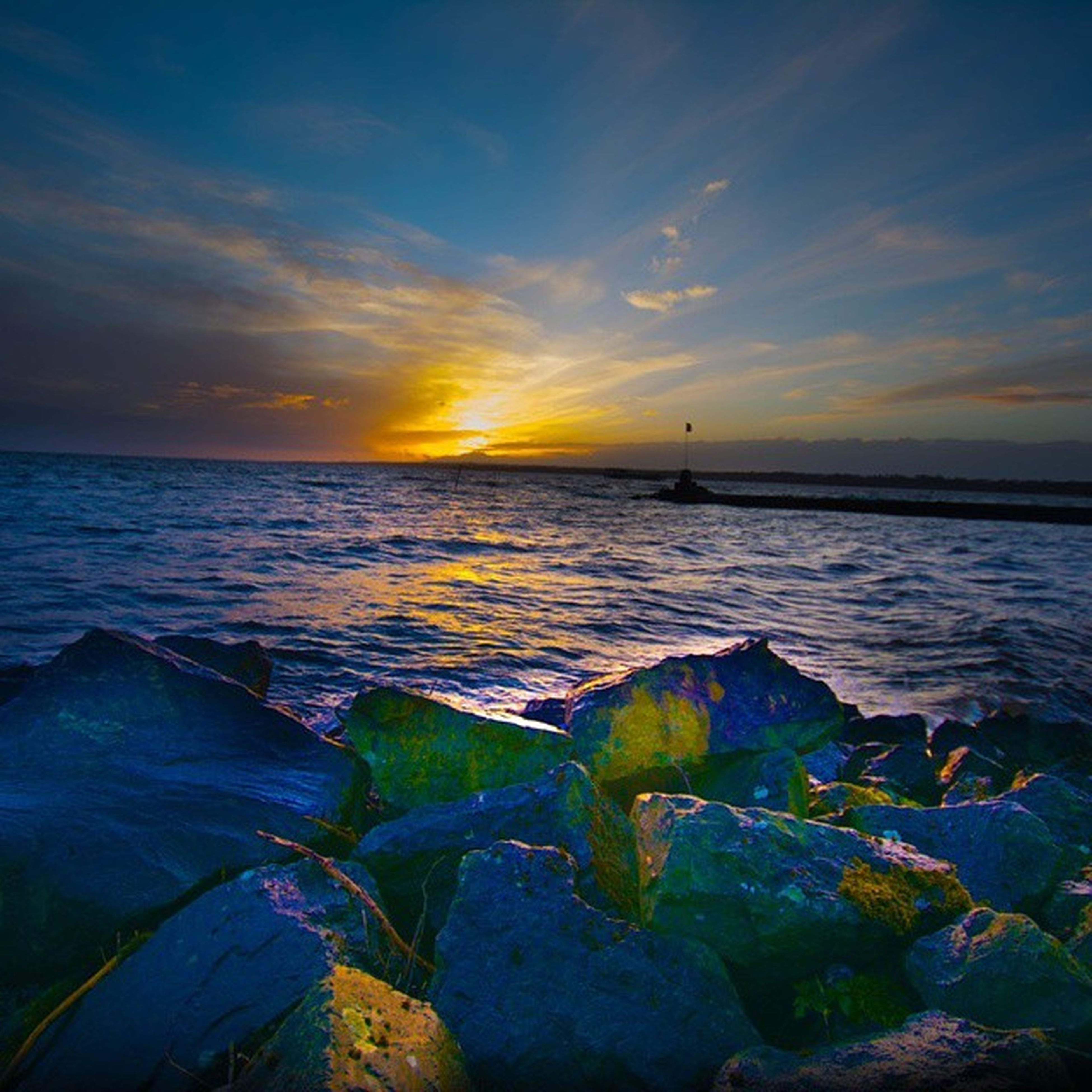 water, sunset, sea, sky, scenics, horizon over water, tranquil scene, beauty in nature, tranquility, nature, rock - object, sun, idyllic, cloud - sky, reflection, sunlight, orange color, shore, remote, outdoors