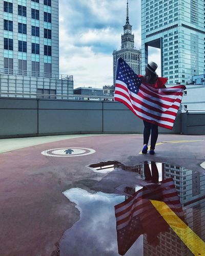 Patriotism Architecture Flag Built Structure Striped City Stars And Stripes Skyscraper Building Exterior Real People Standing Outdoors One Person Day Sky People EyeEm Best Shots EyeEm Team EyeEmBestPics The Week On EyeEm