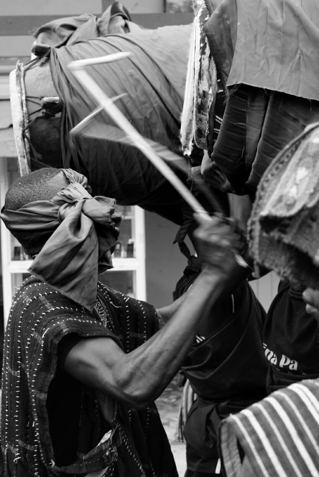 Traditional African funeral drumming. Ghana People African Funeral Ceremony Drummer Drumming On The Streets Blackandwhite Photography Ghana West Africa.