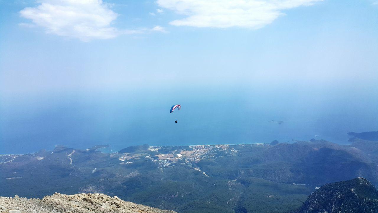 Parachute Over Mountains Against Sky