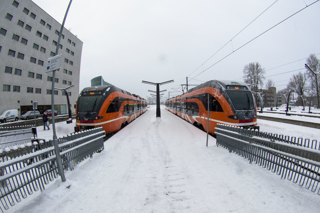 Building Exterior Built Structure City Cold Temperature Day Elron Life In Cold Climate Mode Of Transport No People Outdoors Public Transportation Railroad Track Snow Snowing Stadler Tallinn Train - Vehicle Trains Trainstation Transportation Winter White