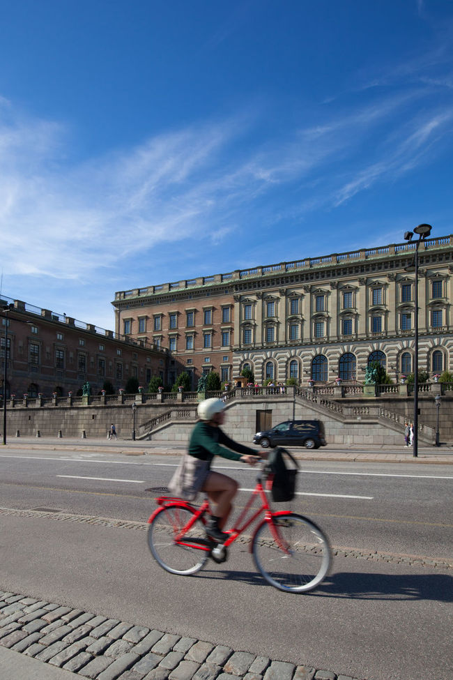 Stockholm, Sweden - Aug 24, 2016 Girl on bicycle passing by the Swedish Royal Palace at Stockholm, Sweden. Stockholm is one of the most bicycle friendly cities in the world. Architecture Bicycle City City Street Day Environment Europe Nordic Countries Riding Scandinavia Stockholm Stockholm, Sweden Sunny Sweden Transportation Travel Travel Destinations