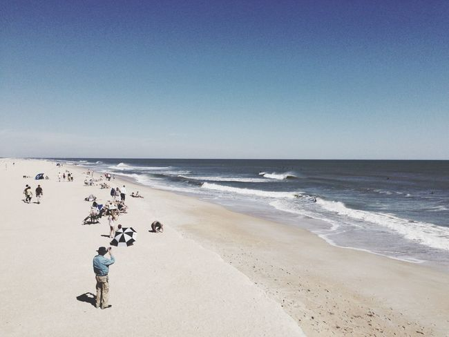 Beach Sea Water Horizon Over Water Shore Vacations Clear Sky Large Group Of People Sand Copy Space Tranquil Scene Blue Scenics Tourist Nature Dramatic Angles People Beauty In Nature Florida