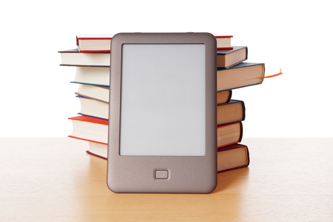 Book Books Copy Space E-book E-book Reader E-reader Ebook Ebook Reader Education Indoors  No People Old And New Pile Reading Stack Table Technology White Background Wireless Technology