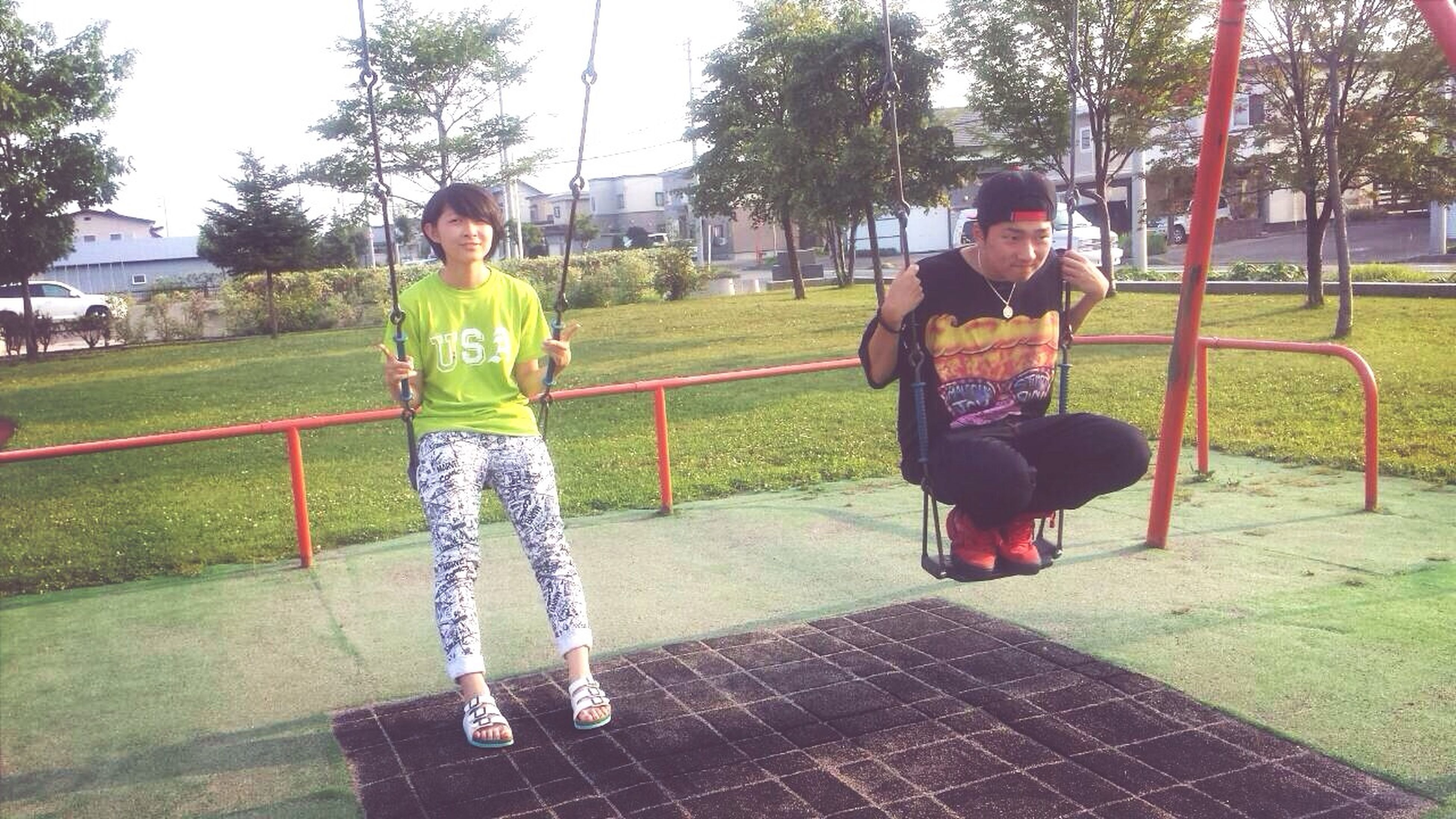 childhood, full length, elementary age, casual clothing, boys, lifestyles, girls, person, leisure activity, innocence, cute, park - man made space, playing, grass, tree, playful, playground, togetherness