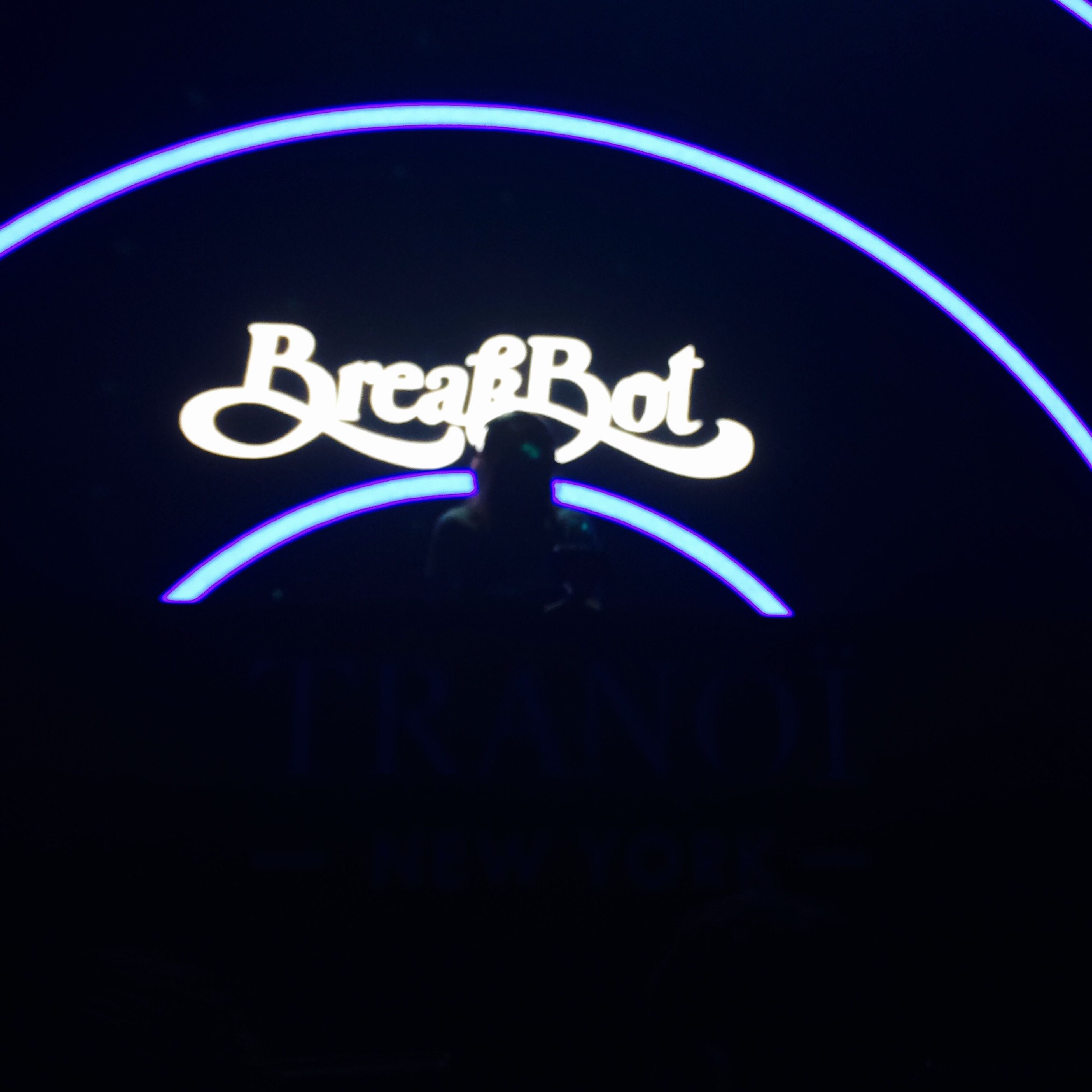 illuminated, night, blue, text, communication, western script, circle, lighting equipment, guidance, light - natural phenomenon, low angle view, dark, glowing, close-up, indoors, sign, neon, human representation, no people, capital letter