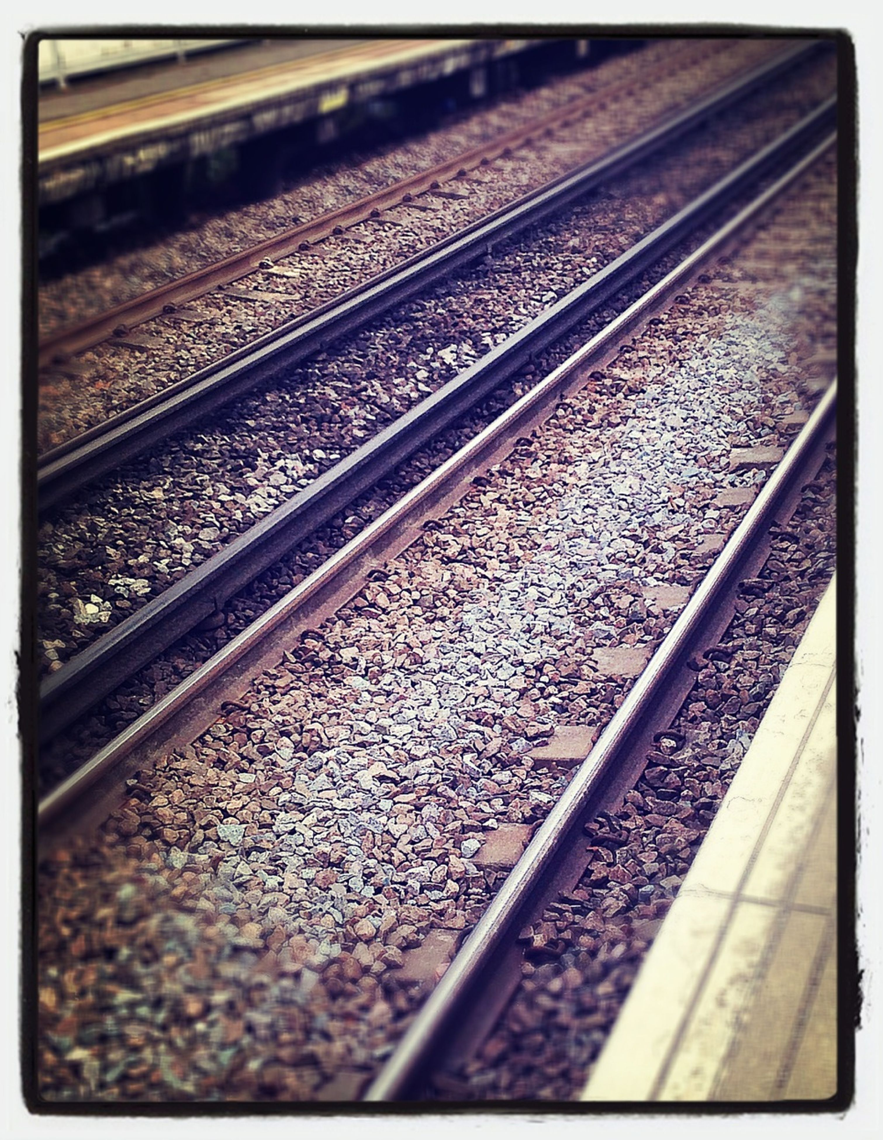 railroad track, rail transportation, transportation, public transportation, railway track, railroad station, railroad station platform, diminishing perspective, high angle view, transfer print, the way forward, travel, auto post production filter, metal, vanishing point, train, train - vehicle, gravel, day, no people