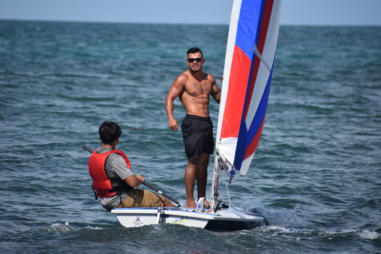 Beautiful Places in Placencia Caribbean Sea Looking At The Cama Saimese Cat Shirtless Day Model Muscular Man Outdoors
