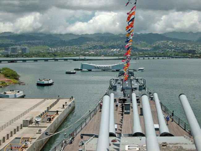 The USS Arizona (BB39) Memorial from the bow of the USS Missouri (BB63). 16 Inch Guns Arizona Memorial Ford Island Gun Turret Architecture Battleships City Cityscape Cloud - Sky Day High Angle View Military Mountain Nature Nautical Vessel Navy No People Outdoors Pearl Harbor Scenics Sea Sky Water