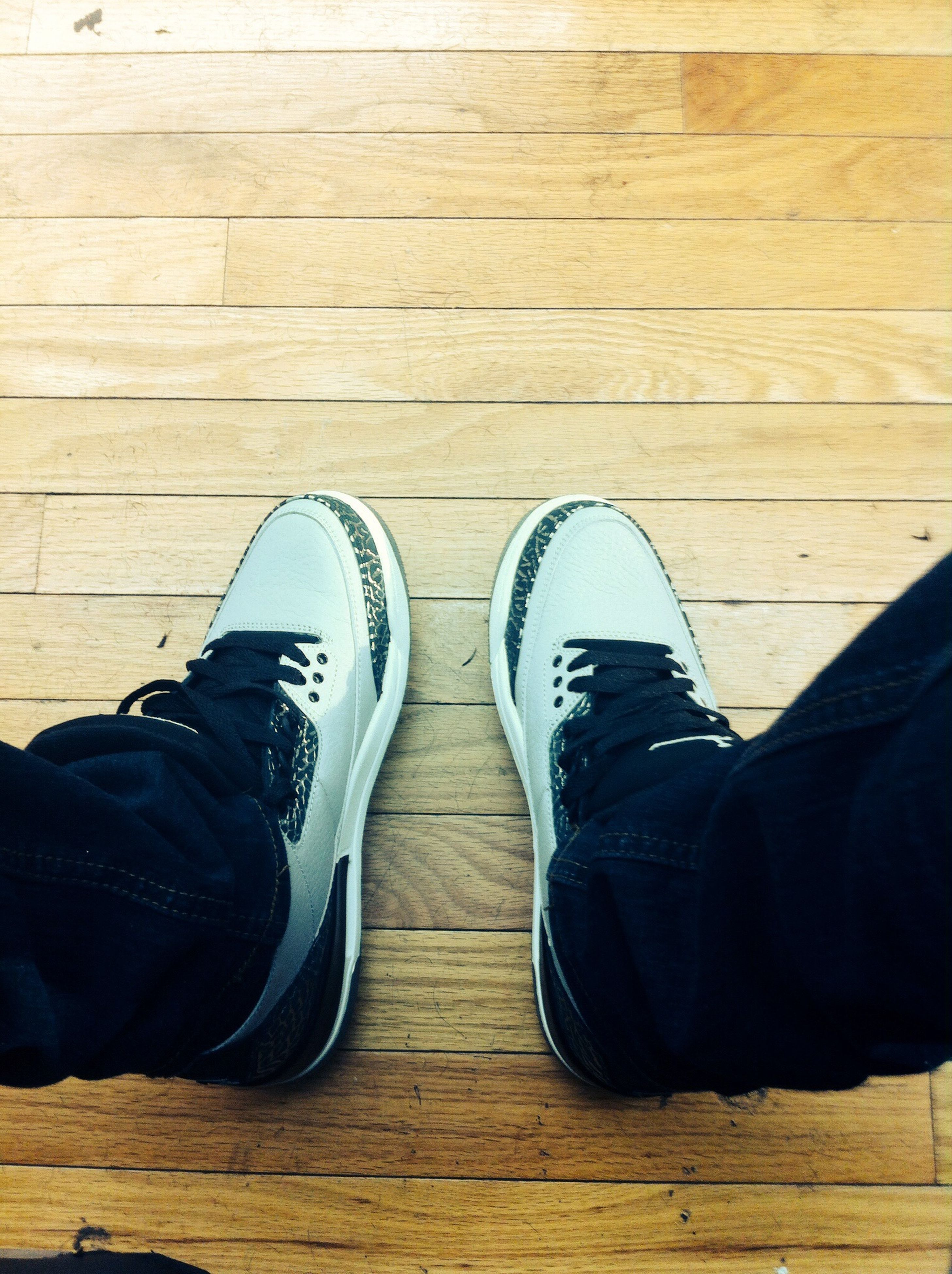 low section, shoe, person, personal perspective, footwear, jeans, lifestyles, standing, human foot, men, canvas shoe, high angle view, leisure activity, directly above, indoors, casual clothing, unrecognizable person