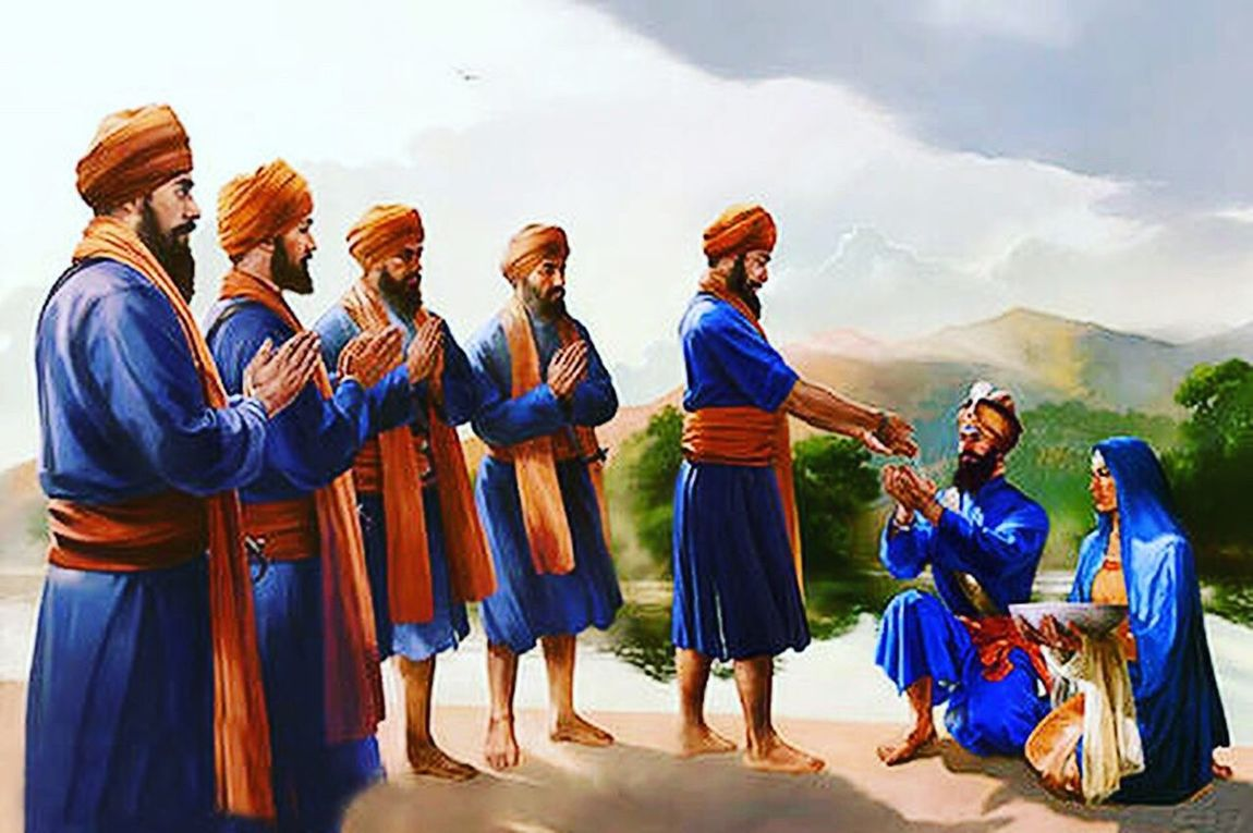 """Vaisakhi Vaisakhi (also spelled Baisakhi) is the festival which celebrates the founding of the Sikh community known as the Khalsa. It is celebrated on April 14 each year. On Vaisakhi day in 1699, Guru Gobind Singh summoned Sikhs from all over India to the city of Anandpur Sahib. At this gathering, the Guru called upon Sikhs to uphold their faith and preserve the Sikh religion. Guru Gobind Singh then lifted his sword and asked that anyone prepared to give his life for his faith to come forward. There was a big silence, but the Guru went on repeating his demand. One Sikh finally came forward and followed the Guru into a tent. Shortly after, the Guru reappeared alone with his sword covered in blood, and asked for a second volunteer. Another Sikh stepped forward and again the Guru took him into the tent, and re-appeared alone with his sword covered with blood. This was repeated until five Sikhs had offered their heads for the Guru. Finally, the Guru emerged from the tent with all five men dressed piously in blue. Guru Gobind Singh called the five Sikhs the Panj Pyare, the Five Beloved Ones. The Panj Pyare were then baptized in a unique ceremony called pahul. Guru Gobind Singh prepared amrit (holy water) in a bowl using a short steel sword. Then the Guru's wife, Mata Sundri, added patashas (sugar crystals) into the amrit. After completing prayers, Guru Gobind Singh sprinkled the amrit on each of the Panj Pyare. The Guru then knelt before the five and asked them to baptize him as well. The Guru proclaimed that the Panj Pyare would be the embodiment of the Guru himself: """"Where there are Panj Pyare, there am I. When the Five meet, they are the holiest of the holy."""" The Panj Pyare were the first members of the new Sikh community called the Khalsa. Guru Gobind Singh gave the Khalsa a unique identity with five distinctive symbols of purity and courage, known today as the Five K's. The Guru gave all Khalsa men the surname of Singh (lion) as a reminder to be courageous. Women to"""