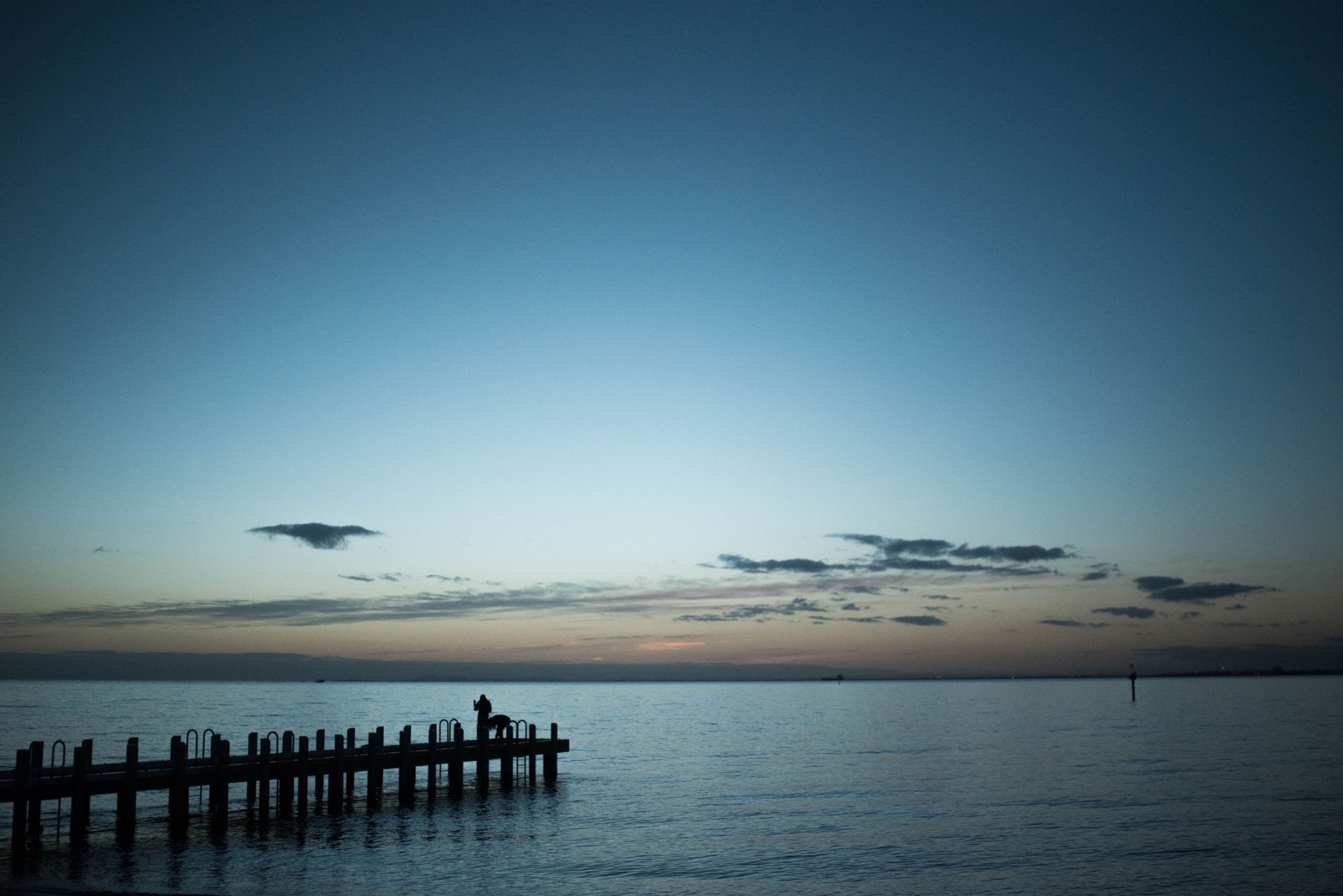 sea, water, horizon over water, pier, tranquility, tranquil scene, scenics, vacations, waterfront, dusk, calm, beauty in nature, idyllic, atmosphere, jetty, ocean, sky, nature, seascape, distant, cloud, tourism, remote, no people, non-urban scene