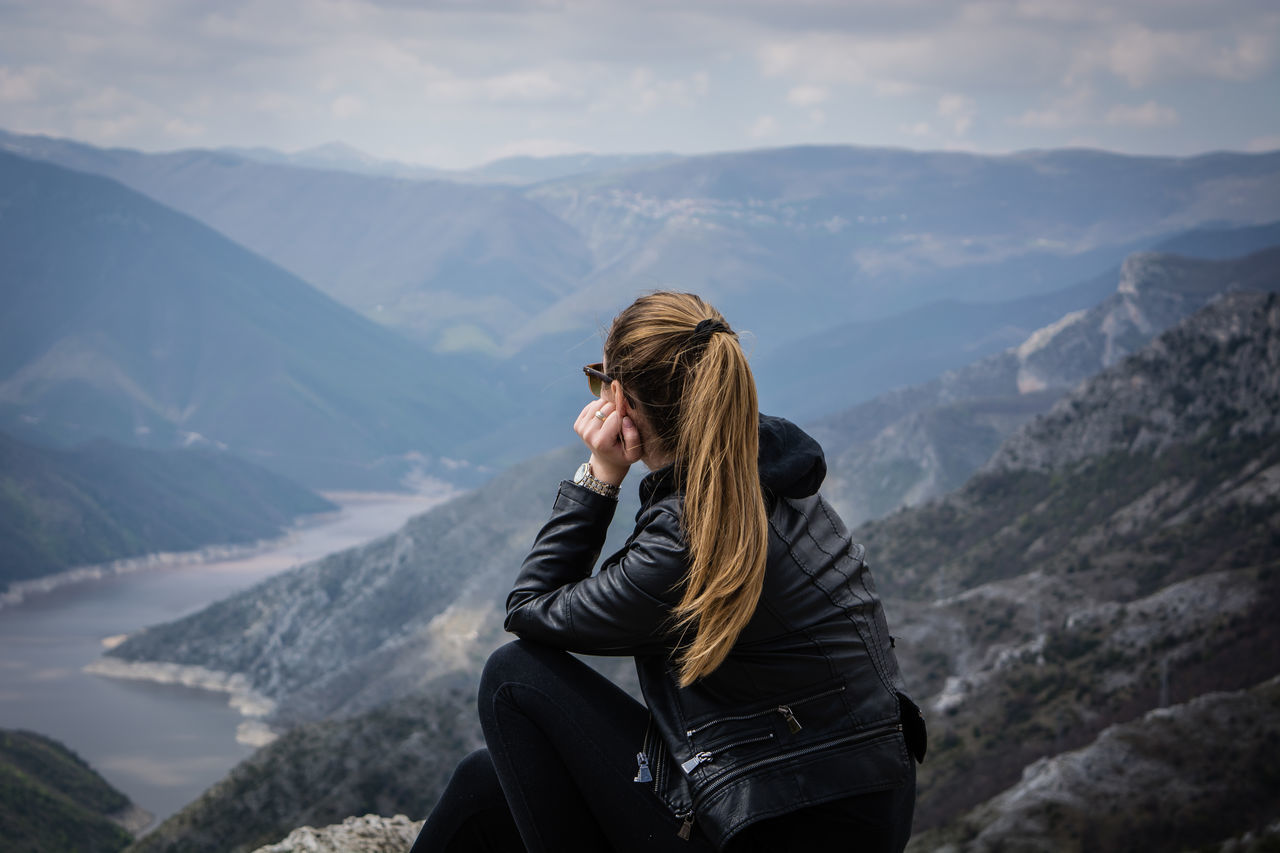 Thinking out loud Beauty In Nature Day Explore Girl Journey Kozjak Lake Leisure Activity Lifestyles Macedonia Mountain Mountain Range Nature Nature One Person Outdoors People Places Portrait Real People Rear View Sky Travel Woman Young Women