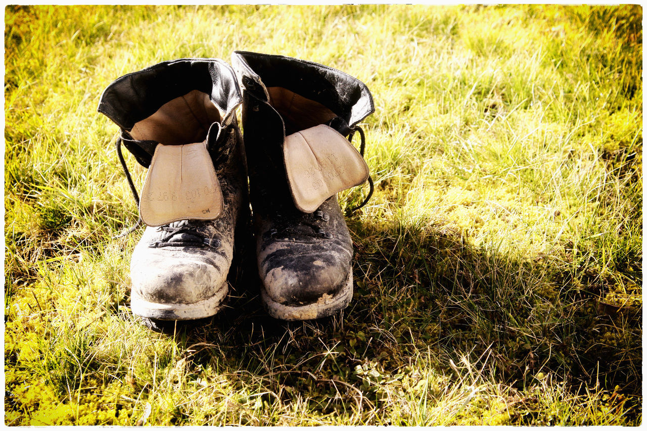 Old shoes Day Field Grass Nature No People Old Shoes Outdoors Shoes