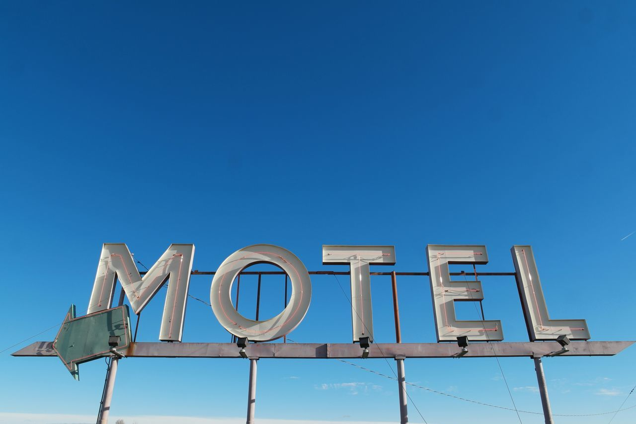 Business No People Office Outdoors Motel Hotel Accomodation Backgrounds Symbol Sky Day Sign Motel Sign Vintage Inn Simplicity Signage Text Arrow Symbol Arrow Old Sign Blue Sky Words Letters Pointing