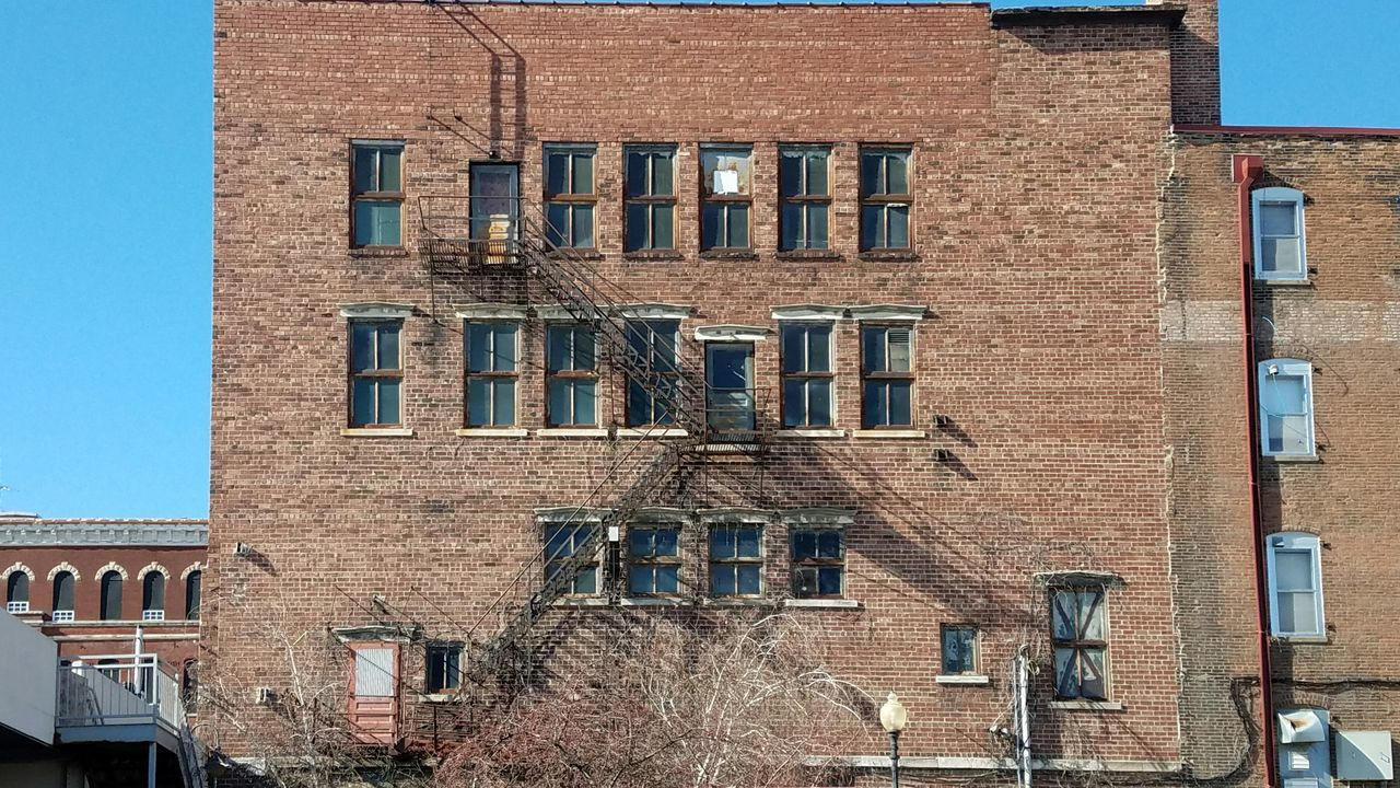 window, architecture, building exterior, built structure, day, no people, outdoors, low angle view, sky, bare tree, city