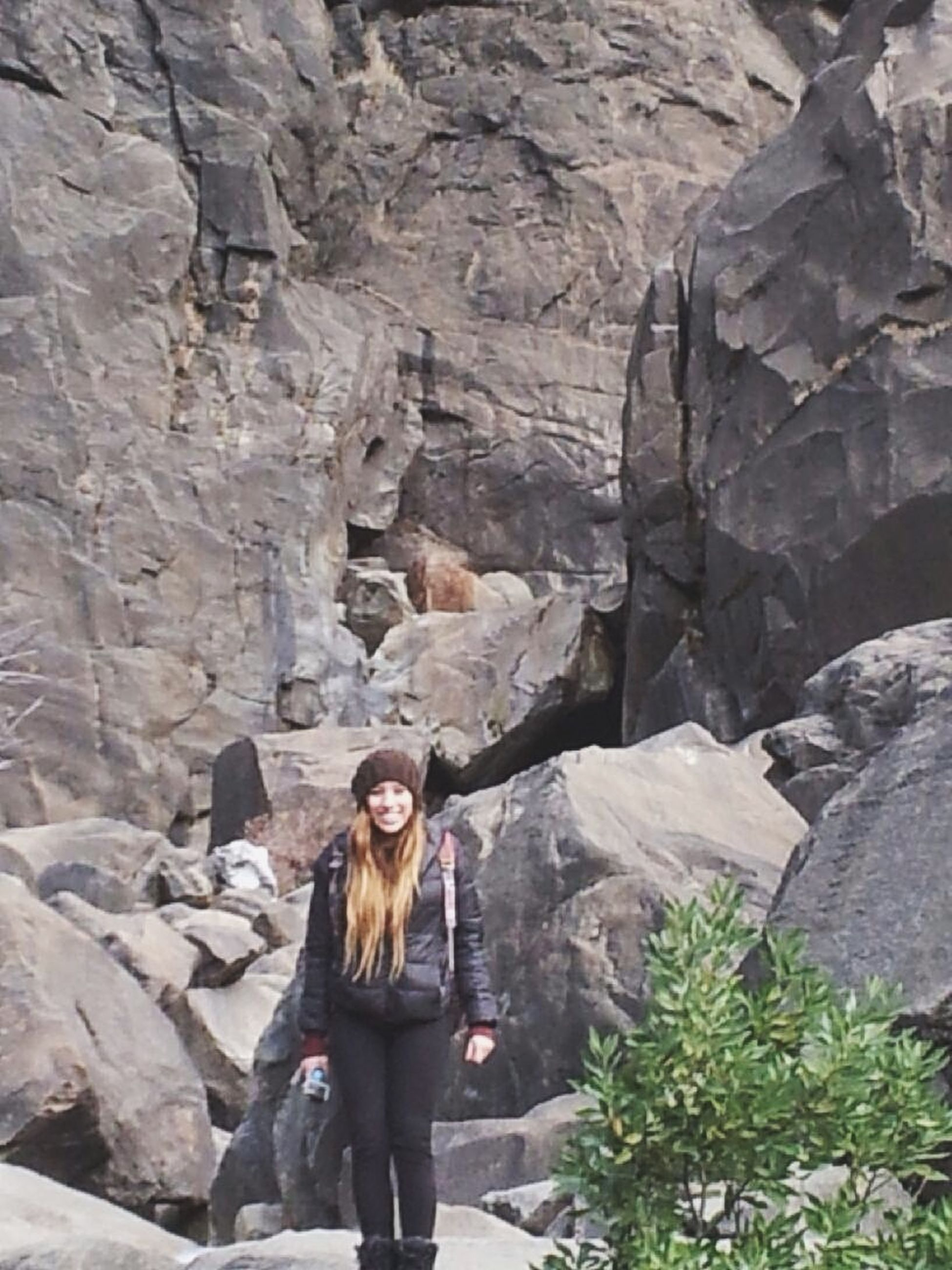lifestyles, leisure activity, young adult, casual clothing, rock - object, young women, full length, person, standing, rear view, rock formation, three quarter length, vacations, nature, day, rock, long hair