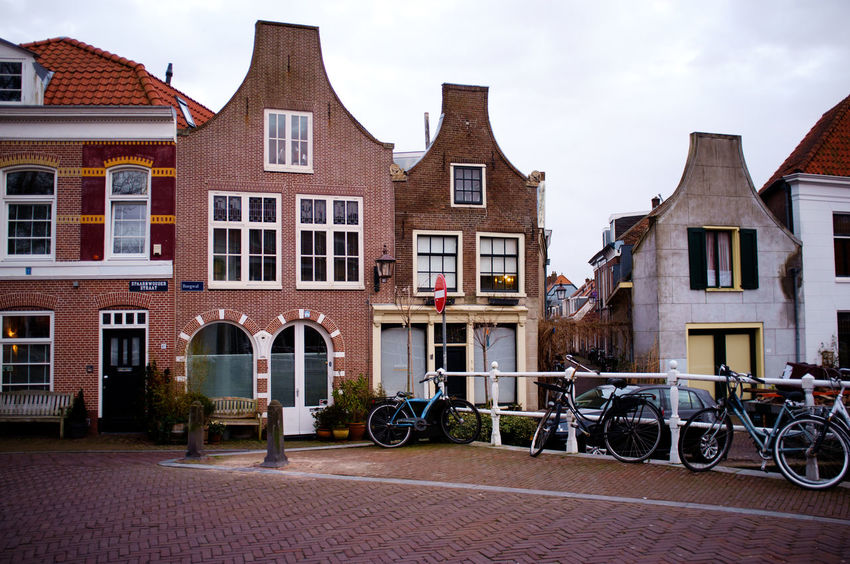 Colors Haarlem Noord Holland X100 Architecture Bicycle Building Exterior Built Structure City Cloud - Sky Day Fujifilm_xseries History House No People Outdoors Residential Building Sky Streetphotography Transportation