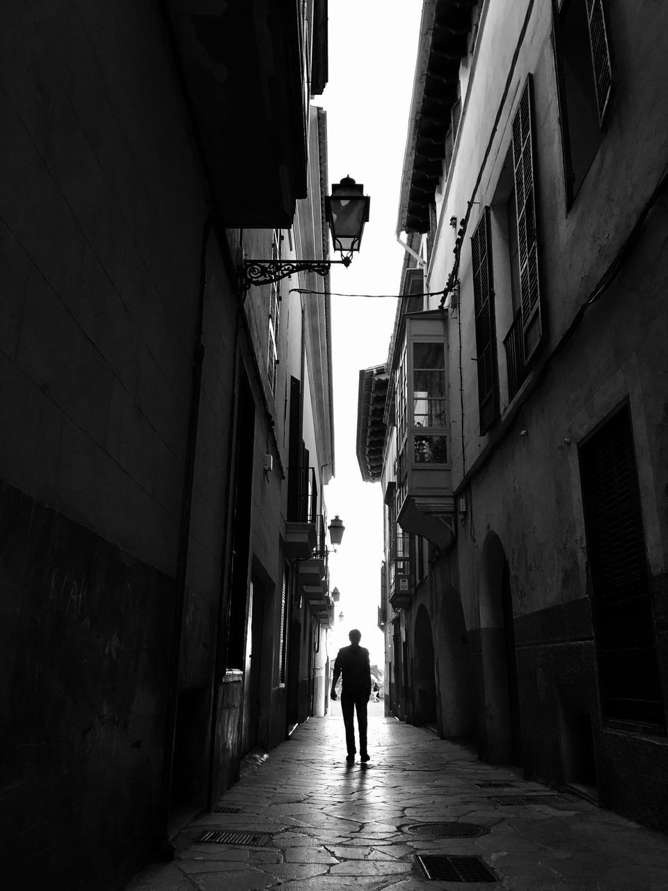 architecture, built structure, walking, building exterior, the way forward, alley, rear view, real people, full length, street, day, men, two people, lifestyles, women, city, outdoors, people