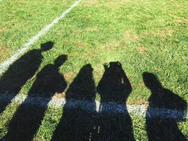 Grass Soccer Field White Stripe Shadow Shadows Selfie ✌ Togetherness Friends Family Friendship People Silhouette Shadows And Silhouettes Outside Diagonal LINE Green Grass Green Field Group Of People Ground Outdoors Unique Perspectives On The Ground Selfies