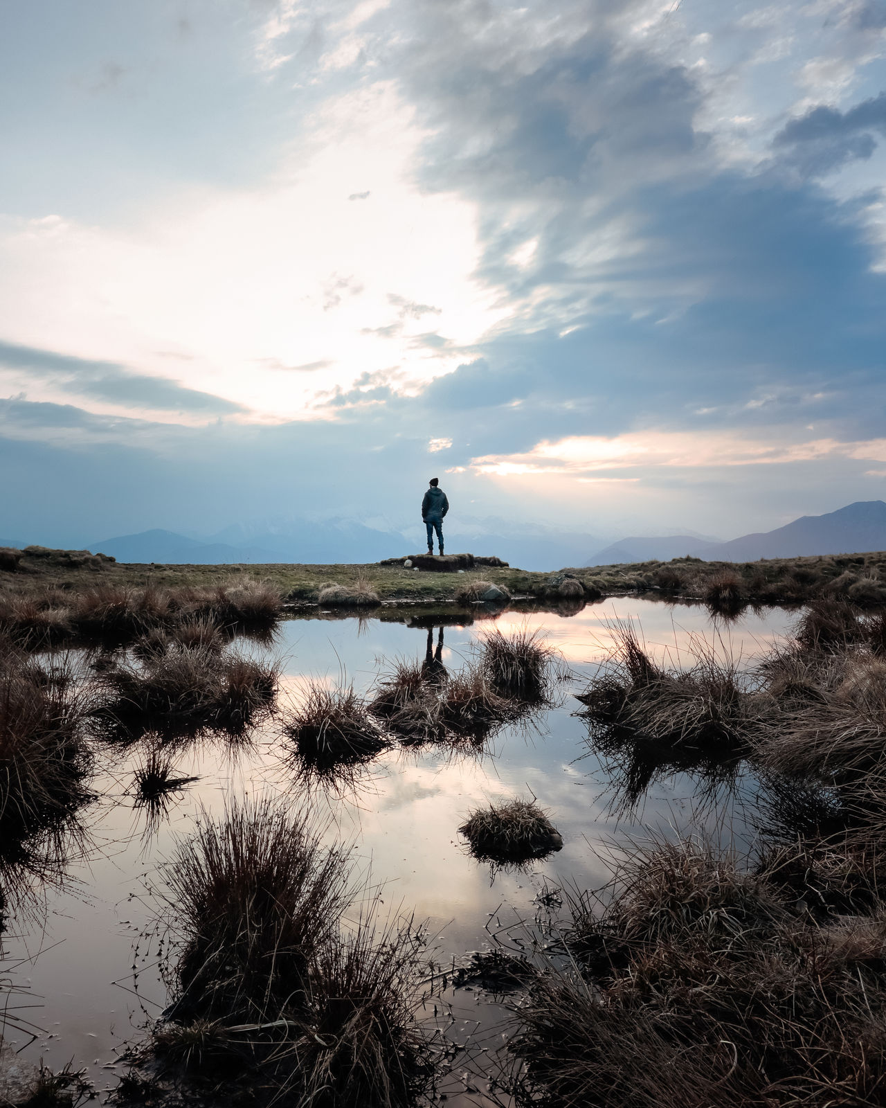 Adventure Back View Beauty In Nature Calm Cloud - Sky Hikingadventures Lake Lonely Mountains And Sky Nature On Top One Person Outdoors Real People Reflections Scenics Silhouette Sky Standing Standing Water Sunset The Great Outdoors - 2017 EyeEm Awards Tranquil Scene Tranquility Wild