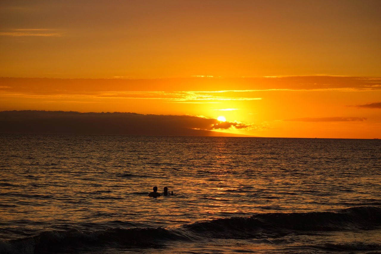Atmosphere Atmospheric Mood Beauty In Nature Cloud - Sky Date Dramatic Sky Horizon Over Water Idyllic Majestic Nature Non-urban Scene Orange Color People And Places Sea Silhouette Sky Sun Sunset Tourism Tranquil Scene Tranquility Travel Destinations Unrecognizable Person Vacations Water