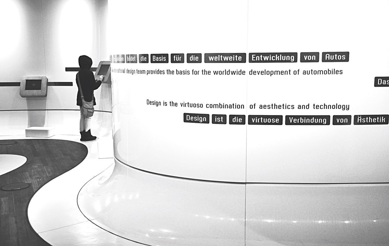 About design... Bnw_friday_eyeemchallenge Museum Time Architecture Interior Bnw_collection Blackandwhite Real People Text One Person Rear View Communication Arts Culture And Entertainment Lifestyles Indoors  Standing Technology Full Length
