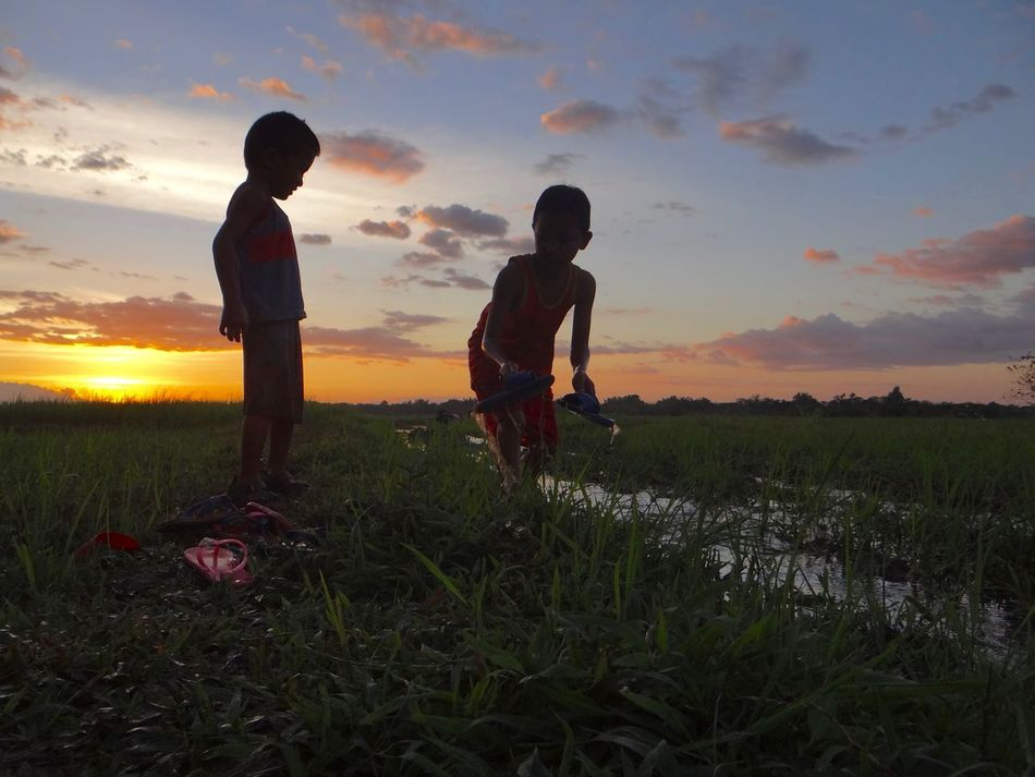Best of friends Beauty Beauty In Nature Boys Child Nature Outdoors People Rice Field Sky Stunning Sunset Sunset Silhouettes Two People Water