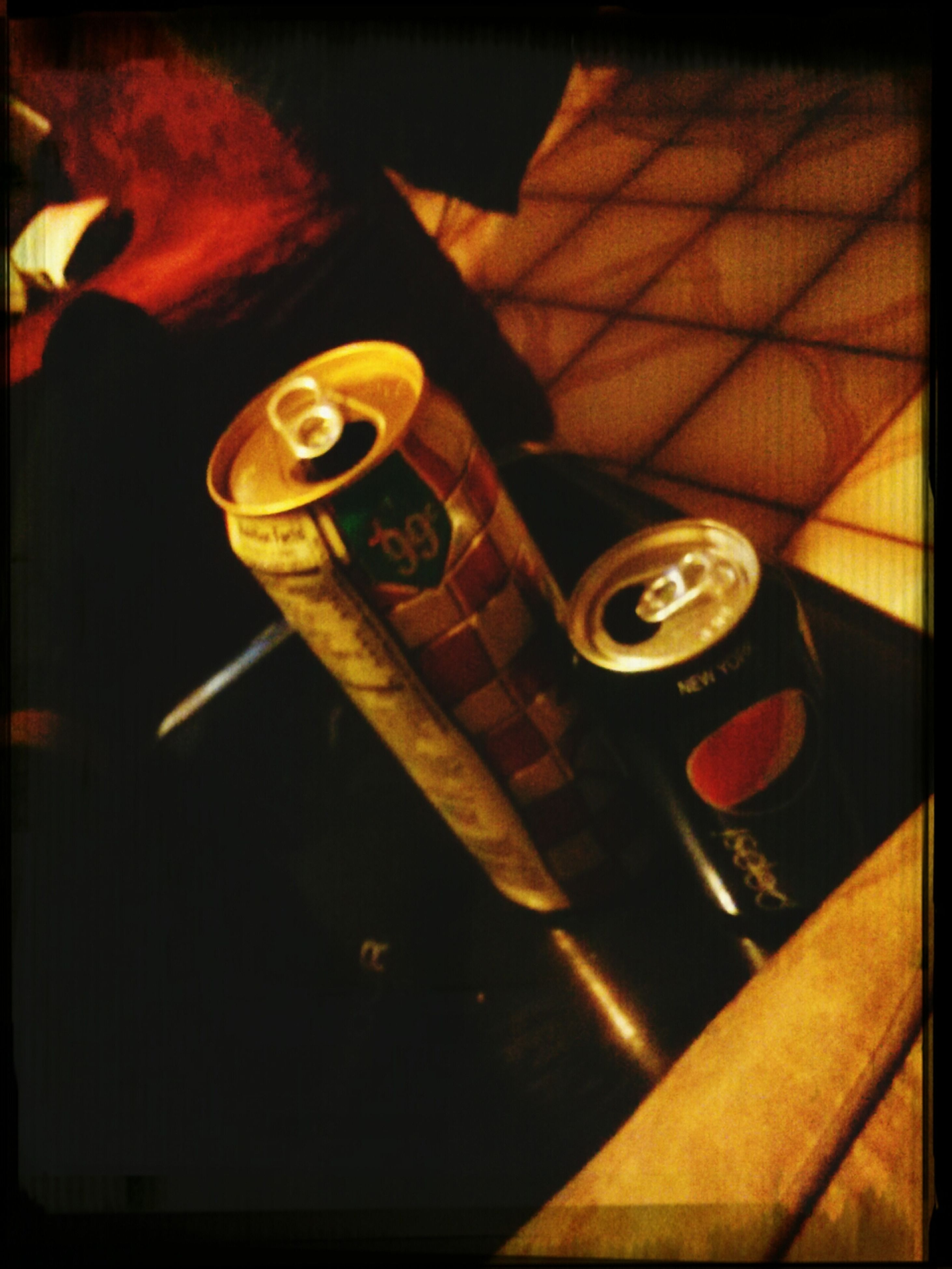 indoors, still life, table, close-up, high angle view, transfer print, auto post production filter, food and drink, wood - material, no people, selective focus, drink, technology, text, focus on foreground, metal, refreshment, part of, elevated view, night